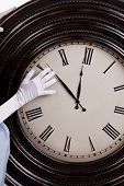pic of cinderella  - A princess hand is changing the time on a big clock - JPG