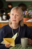Senior Woman With Sympathy Card