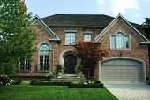 pic of palladium  - new brick house with bright green manicured lawn  - JPG