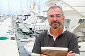 Senior Man On Marina Sport Boats Portrait