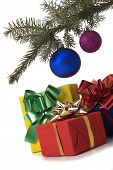 picture of christmas-present  - christmas presents under christmas tree close up - JPG