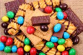 Постер, плакат: A Lot Of Sweets On Jute Burlap Unhealthy Food