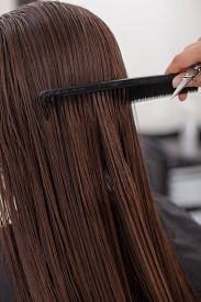 foto of hair comb  - Close up of female arm of hairstylist - JPG
