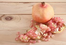image of pomegranate  - Pomegranate fruit is eaten as a sweet or sour and sweet pomegranate is a fruit that have health benefits - JPG