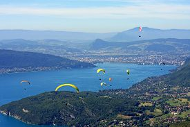 image of annecy  - paragliders flying above Lake Annecy in France - JPG
