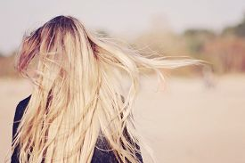 picture of hair motion  - Back view of the young female with beautiful blond straight long hairs in motion - JPG