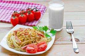 stock photo of carbonara  - Pasta carbonara on the white plate closeup - JPG
