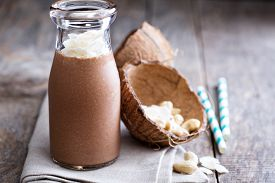 picture of fruit shake  - Healthy vegan chocolate coconut cashew shake in a bottle
