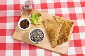 image of canard  - Mushroom pate on a wooden board with pickle - JPG