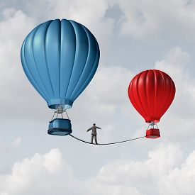 stock photo of dangerous  - Change challenge and caution business motivational concept as person walking on a tight rope high wire from one hot air balloon to another as taking a risk and danger metaphor for changing position or career - JPG