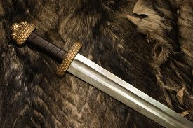 picture of sword  - Still life with ancient scandinavian sword on a fur - JPG