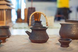 stock photo of raku  - View of oriental ceramic teapot and cups - JPG