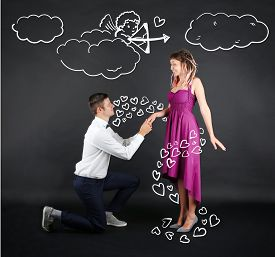pic of cupid  - Young couple with heart and Cupid on black background - JPG
