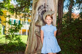stock photo of mary jane  - Outdoor portrait of a cute little girl in the park - JPG