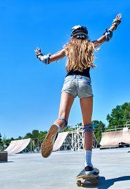 stock photo of skateboard  - Teen skateboarding his skateboard outdoor - JPG