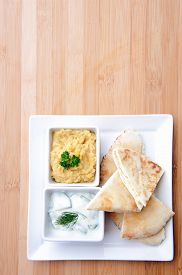 picture of humus  - Variety of dips with flatbread - JPG
