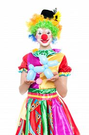 stock photo of clowns  - Beautiful young woman as funny clown with balloon dog - JPG