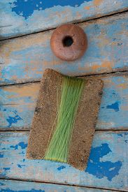 pic of nylons  - a cork wrapped with nylon fishing and a float used for fishing nets - JPG