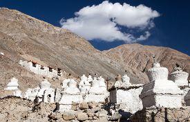 image of karakoram  - Ruins of royal palace with white buddhist stupas in Tiger or Tiggur village in Nubra valley Ladakh Jammu and Kashmir India  - JPG