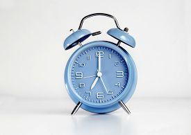 picture of analog clock  - Blue analog retro twin bell alarm clock - JPG