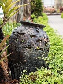 stock photo of pottery  - Mini garden decoration by pottery jar pottery pitcher - JPG