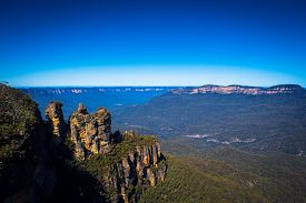 stock photo of three sisters  - Three Sisters rock formation and Jamison valley in Blue Mountains National Park - JPG