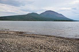 stock photo of plateau  - The lake shore on the Putorana plateau - JPG