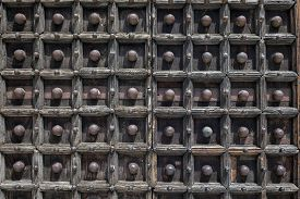 image of anjou  - Medieval wooden doors of the Naples Cathedral the main church of Naples southern Italy commissioned by King Charles I of Anjou completed in the early 14th century under Robert of Anjou.