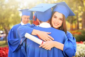 foto of graduation gown  - Graduated students in graduation hats and gowns - JPG