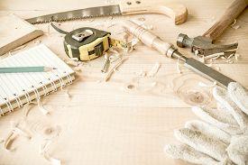 stock photo of chisel  - carpenter toolshammermeternailsshavings and chisel over wood table - JPG