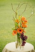 picture of centerpiece  - Floral centerpiece on table on grassy field - JPG
