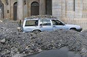 Car Under Stones