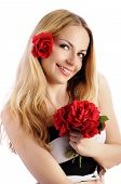 Pretty girl holding a bouquet of roses