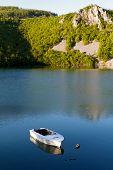 white boat on the rural lake, tranquil scene