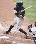 Syracuse Skychiefs' Michael Aubrey takes a big swing at a pitch