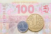 One Kopek And Hrivna Coins Against One Hundred Bill