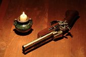 Ancient Pistol And Candle
