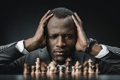 Confused African American Businessman With Chess poster