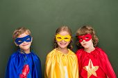 Постер, плакат: Kids In Superhero Costumes