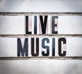A Retro Vintage And Grungy Live Music Sign Outside A Bar Or Pub Or Nightclub poster