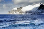 Winter landscape of breathtaking fjords scenery of Senja island in Northern Norway  poster