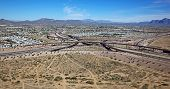 image of superstition mountains  - Aerial view of the East Mesa Interchange of Loop 202 and the Superstition Freeway - JPG