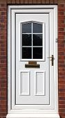 white front door in a red brick  building,uk