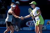 MELBOURNE - JANUARY 27: Svetlana Kuznetsova (R) and Vera Zvonareva of Russia winning the doubles championship at the 2012 Australian Open on January 27, 2012 in Melbourne, Australia.
