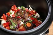 Delicious Pork Ribs With Vegetables In Multi Cooker, Closeup poster