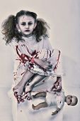 Halloween Theme: Girl Child Zombie or Ghost covered in blood holding baby doll.