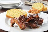 image of baby back ribs  - Baby back ribs and cornbread with barbecue sauce - JPG