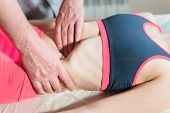 Male Manual Visceral Therapist Masseur Treats A Young Female Patient. Edit The Internal Organs And T poster
