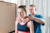 Male Manual Visceral Therapist Masseur Treats A Young Female Patient. Warm Up The Shoulders And Neck poster