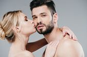 Attractive Nude Woman Kissing Cheek Of Handsome Bearded Man On Grey poster